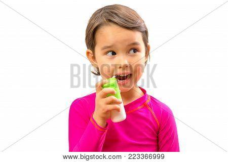 Little Girl Using Mouth Spray For Caugh