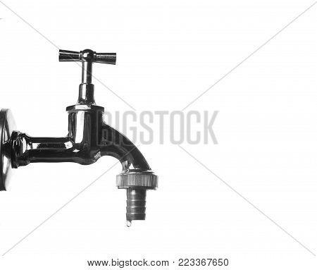 metal tap water dripping on white background
