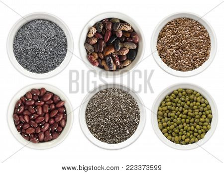 Set of superfood isolated on white background. Superfood with copy space for text. Seeds of flax, poppies, beans, mung beans, chia. Top view. Seeds in a bowl isolated on white background.