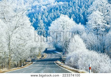 Icy road usable for traffic information or travel magazine with free space for text.