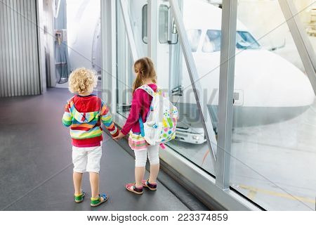 Kids Travel And Fly. Child At Airplane In Airport