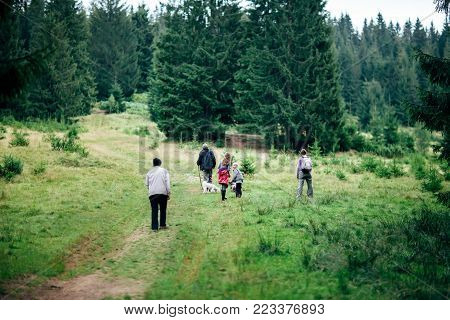 Portrait Of Happy Family Against Tree Background Outdoors