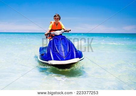 Surfer On Tropical Beach. Boy Surfing.