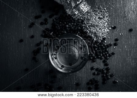 Black Pepper,piper Nigrum And Its Tea With Powder Of Black Pepper On Wooden Surface.