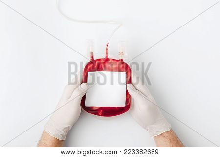 top view of hands in gloves holding blood for transfusion isolated on white background