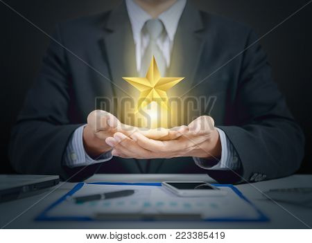 businessman and star evaluation on hand, winner concept
