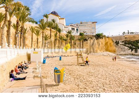 Benidorm, Spain - January 14, 2018: People enjoying holiday in Cala Mas Pas Beach in Benidorm, Alicante, Spain