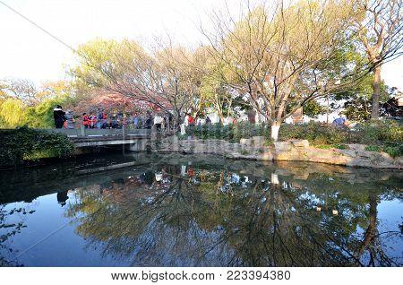 HANGZHOU, CHINA-JAN 08, 2018: Unidentified people walk around the beautiful scenic area in West lake in Hangzhou, China.