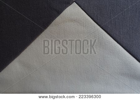 Brown and beige fabric sewn together (triangular gusset)
