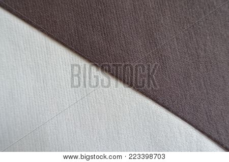 Brown and white fabrics sewn together diagonally