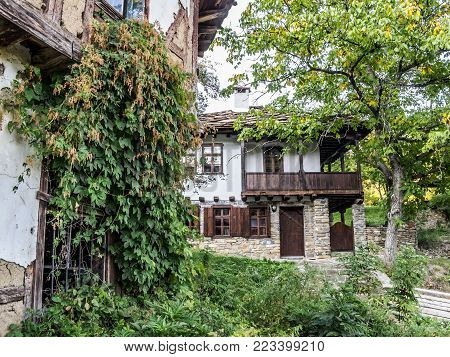 Old houses in the typical Bulgarian Revival style at Baba Stana Neighborhood, Oreshak, Bulgaria poster