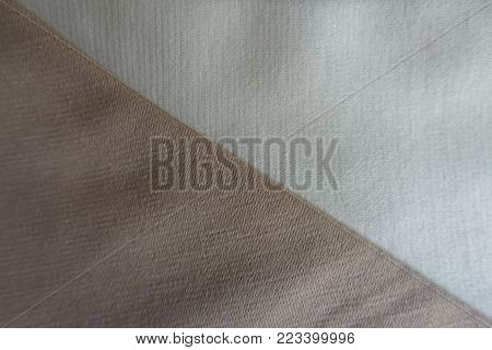 White and beige fabrics sewn together diagonally