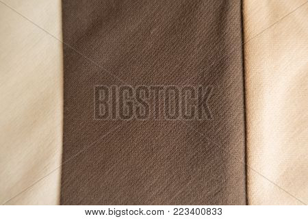Vertical brown stripe sewn to beige fabric