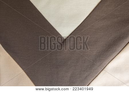 V shaped brown stripe sewn to beige fabric