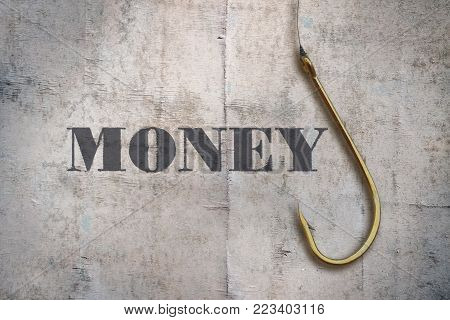 Word Money written on vintage background and a fishing hook
