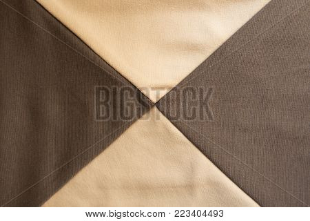 X shaped seams between beige and brown fabrics