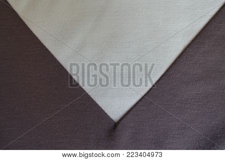 Light beige triangular gusset sewn to brown fabric