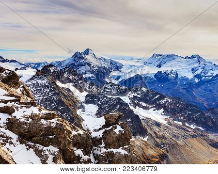 A wintertime view from Mt. Titlis in Switzerland. The Titlis is a mountain, located on the border between the Swiss cantons of Obwalden and Bern, it is usually accessed from the town of Engelberg.