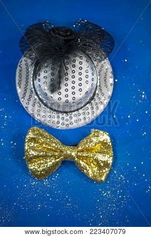 hat and bow tie, blue background, party, carnival, New Year's Eve