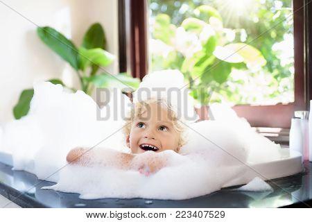 Child In Bubble Bath. Kid Bathing. Baby In Shower.