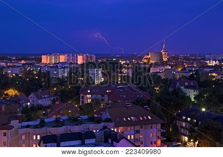 LIGHTNING IN THE NIGHT SKY - Illuminated cityscape of the city on a stormy night