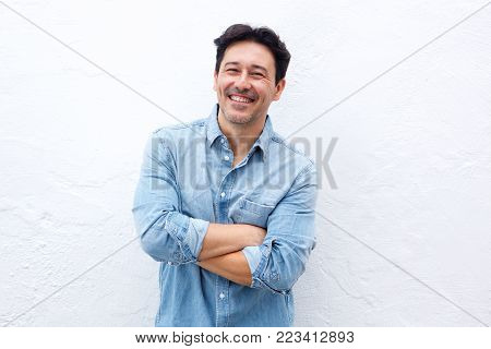 Handsome Middle Aged Man Smiling Against White Wall