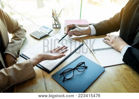 Young Business Team Working With New Startup Project Offering Contract Paper To His Business Partner