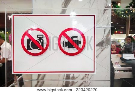 BANGKOK, THAILAND - JANUARY 06: Cashier in the food court of The Mall Bangkhae posts sign to forbid camera usage in Bangkok on January 06, 2017.