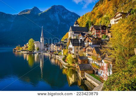 Scenic picture-postcard view of famous Hallstatt mountain village with Hallstatter See in the Austrian Alps in beautiful golden morning light in fall, region of Salzkammergut, Austria