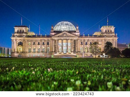 Panoramic view of famous Reichstag building, seat of the German Parliament (Deutscher Bundestag), in twilight during blue hour at dusk, Berlin, Germany