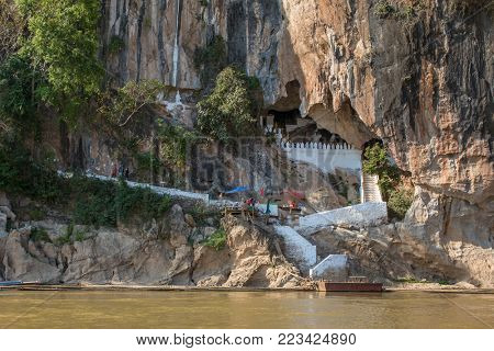 Luang Prabang, Laos - January 25, 2017: Famous Pak Ou Cave and Mekong river in Laos