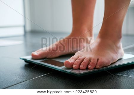 Female Bare Feet With Weight Scale
