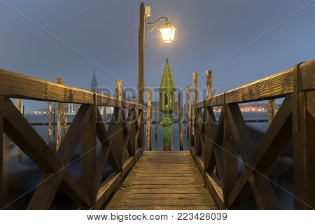 wooden pier with handrails in Venice by night