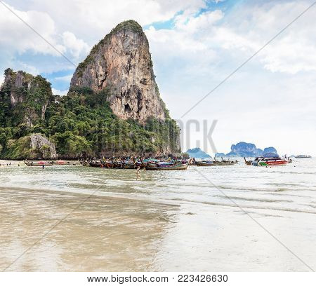 Thailand, Krabi province, Railay beach - 2017 February 25: Amzing landscape with traditional longtail boats, on tropical Andaman sea. Popular famous travel vacation destination.