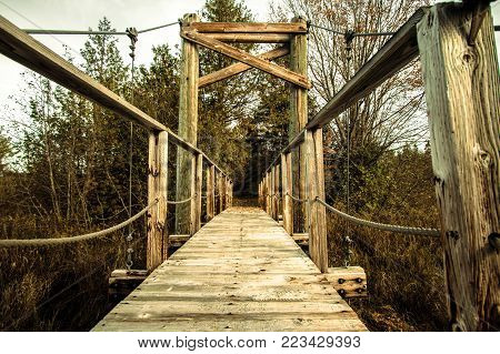 Crossing Over Background. Wooden footbridge over a river along a remote portion of the North Country Trail in the Hiawatha National Forest of Michigan.