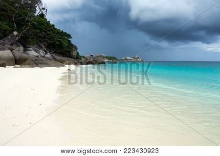 Landscape with white sand beach and storm sky on Similan islands, Thailand