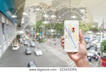 female hands holding a smart phone showing part of navigator map on connection line over the world map with blurred photo of traffic jam, Navigation concept,Elements of this image furnished, 3D illustration