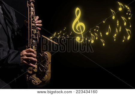 Closeup saxophone in player action on a dark background with music melody, musical concept, 3D illustration