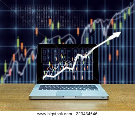 Stock exchange market trading graph over the screen of computer laptop on wood table over the photo blurred of trading graph background, business marketing trade concept, 3D illustration
