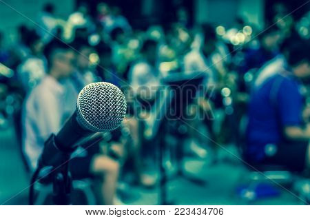Microphone over the Abstract blurred photo of classic music band when rehearsal, musical concep, seminar meeting concept