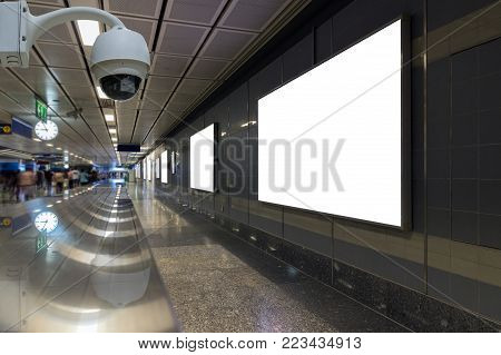 Security camera monitoring on the Blank billboard located in underground hall or subway for advertising, business advertise and security concept