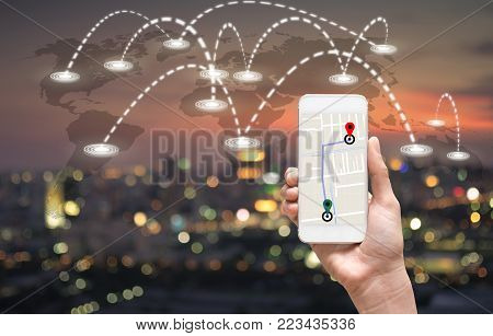 female hands holding a smart phone showing part of navigator map over screen on connection line over the photo blurred of cityscape with world map which dicut each elements, Navigation concept, 3D illustration