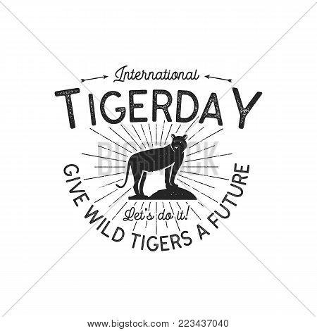 International tiger day emblem. Wild animal badge design. Vintage hand drawn typography logo of tigerday with sun bursts. Stock vector illustration isolated on white background.