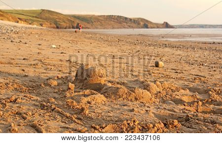 Sandcastles on Newgale beach in evening light