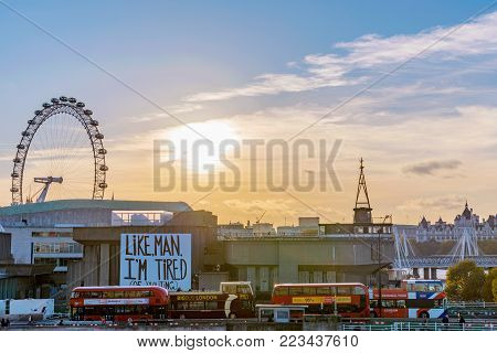 LONDON, UNITED KINGDOM - NOVEMBER 07: City view of central London during sunset with the famous London Eye ferris wheel on November 07, 2017 in London