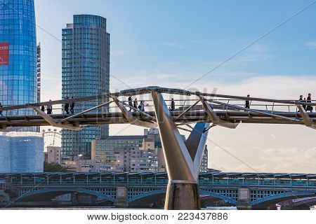LONDON, UNITED KINGDOM - NOVEMBER 06: View of the Millenium bridge and modern London skyscrapers on November 06, 2017 in London