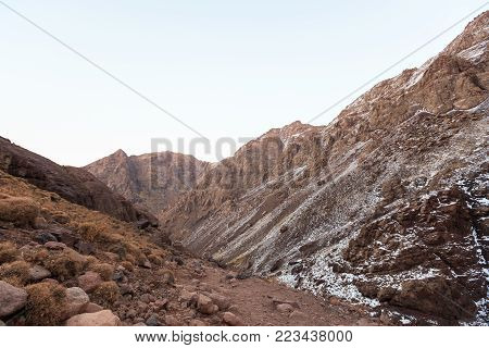 High Atlas Mountains. Walking hiking trail. Morocco, winter. Wild nature landscape.