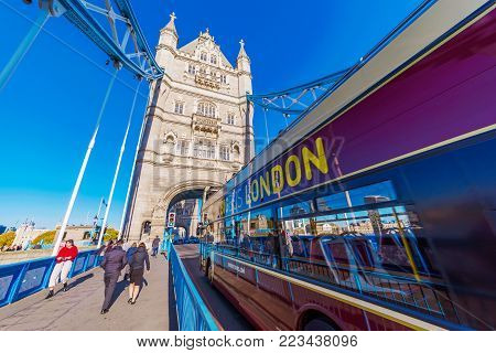 LONDON, UNITED KINGDOM - NOVEMBER 06: View of Tower Bridge with a London tourbus on November 06, 2017 in London