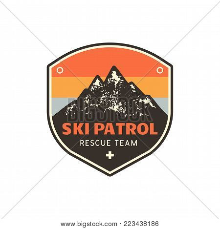 Vintage hand drawn mountain ski patrol emblem. Rescue team patch. Mountains stamp. Retro colors, grunge letterpress effect. Stock vector retro badge illustration isolated on white background.
