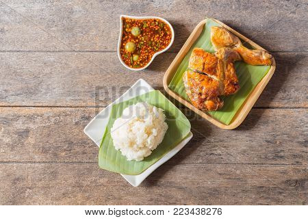 top view concept of hipster special thai food (batter-fried prawns,spring rolls,fried chicken,spicy green papaya salad